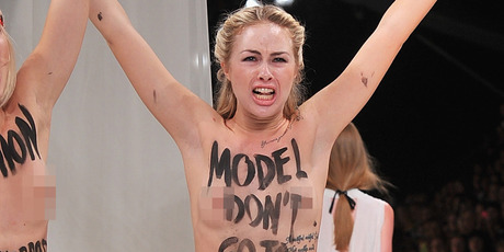 Topless activists disrupt a Nina Ricci show during Paris Fashion Week.Photo / Getty