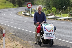 Peter Thomas wheels his buggy on the Coromandel Peninsula. Picture / Mark Mitchell