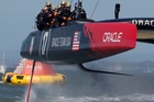 Oracle Team USA cross the finish line ahead of Emirates Team New Zealand in Race 18 yesterday to level the race tally at 8-all. Photo / Brett Phibbs