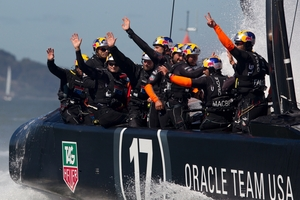A jubilant Oracle Team USA acknowledge cheers from their supporters after yesterday's win. Photo / AP