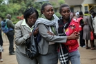 Relatives of Westgate Mall victim Johnny Mutinda Musango, 48, weep after identifying his body. Photo / AP