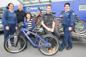 COMMUNITY SPIRIT: School community officer Constable Keely Rewai-Couch (left), road safety manager Dave Ryan, Avanti Plus owners Deb Allen and Ben Knight, and school community officer Constable Susan Esler. PHOTO/LYNDA FERINGA