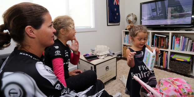 Suzy McAsey watches the America's Cup with daughters Brooke and Billie after being away from home for two-and-a-half months. Photo / John Stone