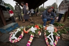 A street seller prepares wreaths for the dead. Photo / APPictures / AP