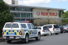 Police outside Kaikohe New World after yesterday's armed robbery. Photo / Peter de Graaf