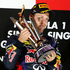 Red Bull driver Sebastian Vettel of Germany, holds the trophy during the awards ceremony the Singapore Formula One Grand Prix on the Marina Bay City Circuit in Singapore. Photo / AP