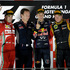 Sebastian Vettel, second right, celebrates with his team principal Christian Horner, Ferrari driver Fernando Alonso, left, finished second and Lotus driver Kimi Raikkonen finished third. Photo / AP