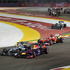 Red Bull driver Sebastian Vettel of Germany, front right, leads the field into turn three at the start of the Singapore Formula One GP. Photo / AP