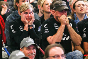 New Zealand fans watch race 13 of the America's Cup between Emirates Team New Zealand and Oracle Team USA at Shed 10. Photo / Getty Images.