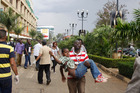 A rescue worker helps a child outside the Westgate Mall in Nairobi, Kenya. Photo / AP