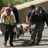 A wounded man is carried by medical personnel outside the Westgate Mall. Photo / AP
