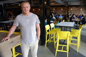Owner Andrew Clapham at his new restaurant Tom Tom Bar and Eatery in Victoria Park Market.