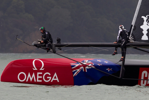 Emirates Team New Zealand adjust their headsail before their postponed duel with Oracle Team USA today. Photo / Brett Phibbs
