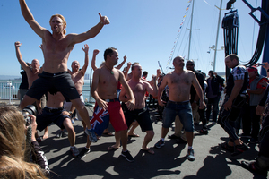 Emirates Team New Zealand supporters deliver a haka, after the dock out, at America's Cup Park before Race 17 of the America's Cup. Photo / Brett Phibbs