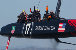Oracle Team USA crosses the finish line ahead of Emirates Team New Zealand, but did anybody in the US notice? Photo / Brett Phibbs