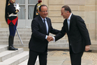 Francois Hollande greets John Key at the Elysee Palace yesterday during Mr Key's trip to Europe. Photo / Claire Trevett