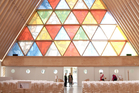Christchurch's innovative Cardboard Cathedral resembles a huge fin from afar and features a stunning triangular stained glass window. Photo / Ben Crawford