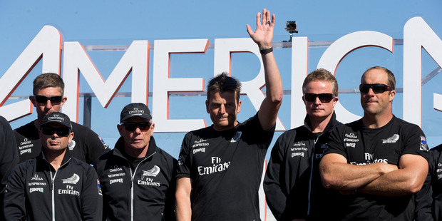 Dean Barker with his team at the cup presentation, after losing in final Race of the America's Cup. Photo / Getty Images
