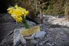 A tribute to Connor Hayes and Joanna Lam left by the Haast community on the Haast Pass, where the couple were swept off the road. Photo / Christine Cornege