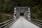 The Haast Bridge on the Haast Pass Highway, from where Hayes and Lam were swept off. Photo / Christine Cornege