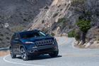 The Jeep Cherokee in action, on and off road. It has done away with the old boxy style inside and out. Pictures / Barry Hathaway