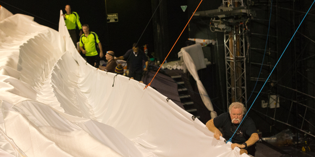 Rigging crews wrestle with the five-storey Imax screen at Event Cinemas in Auckland City. Photo / Greg Bowker