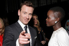 Hollywood actors Michael Fassbender  Lupita Nyong'o.  Photo / AP