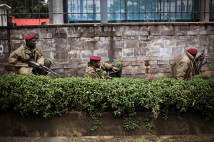 Kenya security forces are seen behind a wall outside the Westgate Mall in Nairobi, Kenya. Photo / AP