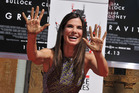 Sandra Bullock poses at her hand and footprint ceremony at the TCL Chinese Theatre in Los Angeles. Photo / AP