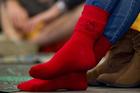 Emirates Team New Zealand fans wear lucky red socks.Photo / Richard Robinson
