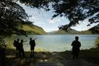Hikers at a rest stop on a guided hike around Lake Waikaremoana. Photo / Amos Chapple