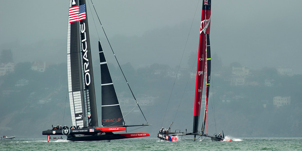 Emirates Team New Zealand and Oracle Team USA in the restart for race 13. Photo / Chris Cameron
