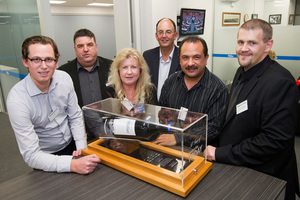 From left, Doug Peacock, Hawke's Bay Today editor Andrew Austin, Natalie Rogers,Russell Broughton, Willy Ransfield and Robert Cimino, with the wine cask made by Design Studio.