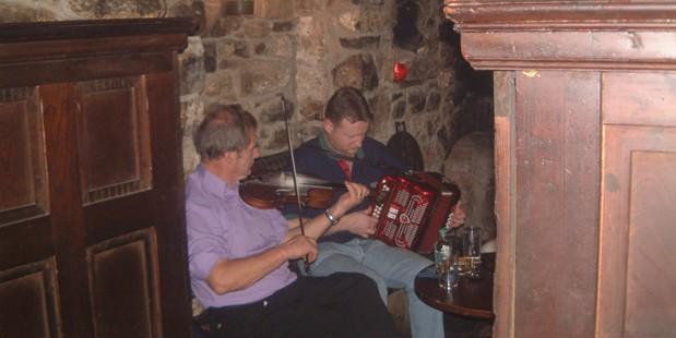 Two musicians liven up proceedings in a Dublin basement pub. Photo / Paul Rush