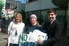 Surfing champ, Mischa Davis, Fi Gibson of Oil Free Wellington and Green Party energy spokesman Gareth Hughes outside Mbie this afternoon with their oil exploration bid.