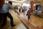 Abdul Haji reaches out for Portia Walton as she runs toward him in the Nairobi shopping centre. Photo / Reuters