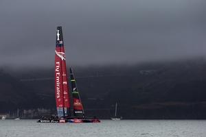 Emirates Team New Zealand, against a backdrop of bad weather and a changed wind direction yesterday, is left in the doldrums yet again yesterday in the America's Cup. Photo / Brett Phibbs