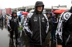 Team NZ skipper Dean Barker dockside in the rain before yesterday's America's Cup racing was postponed because of the wind direction. Photo / Brett Phibbs