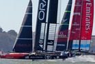 Oracle Team USA beats Emirates Team New Zealand to the first mark in Race 14 of the America's Cup. Photo / Brett Phibbs