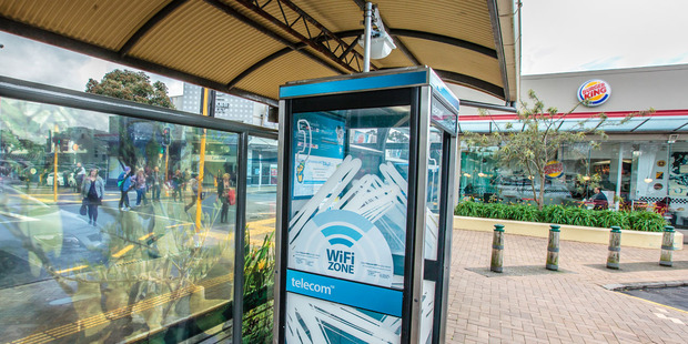Loading One of Telecom's new WiFi hotspot phoneboxes, with the new equipment installed on top.