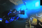 A diver conducts a survey on the Rena. Photo / Supplied