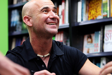 Andre Agassi signs copies of his autobiography, Open, at Paper Plus Newmarket. Photo / Getty Images.