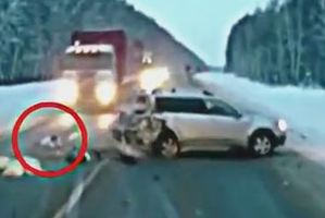 An image from the moment a truck headed towards a baby lying in the middle of a motorway following a crash. Photo / Supplied/ YouTube