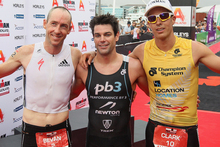 Bevan Docherty of New Zealand (L), Christian Kemp of Australia and Clark Ellice of New Zealand (R) pose after placing at t