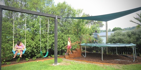 A shade sail is an excellent way to keep kids out of direct sunlight as they play. Photo / Jason Dorday