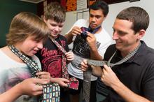 Teacher Chris May shows Cameron Mackintosh, Hans Tilsley and Joseph Tauheluhelu a useful male skill. Photo / Stephen Barker
