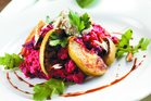 Beetroot risotto with baked apples, rocket and balsamic glaze. Photo / Supplied
