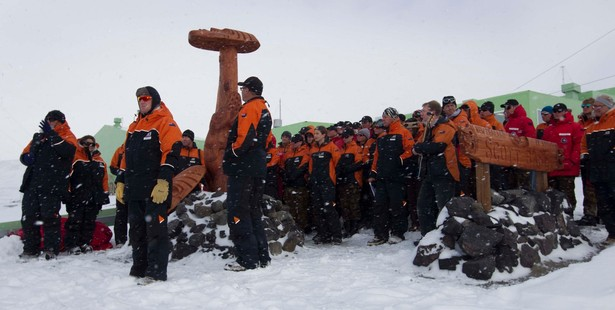 Prime Minister John Key unveils the new maori statue and sign in front of Scott Base in Antarctica today. Photo / Alan Gibson