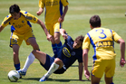 Auckland City's Albert Riera (centre) clashes with Aajay Cunningham of Otago United. Photo / Richard Robinson