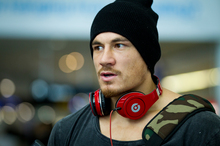Sports star Sonny Bill Williams at Auckland International Airport after flying in from Japan. Photo / Dean Purcell.
